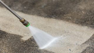 Pressure washer spray cleaning